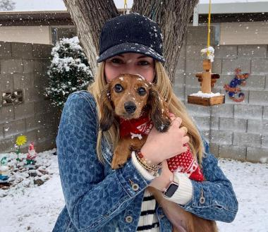 Karlie Fisher and her dog in the snow