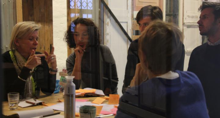 Image of Claire Bates and 4 colleagues at a table